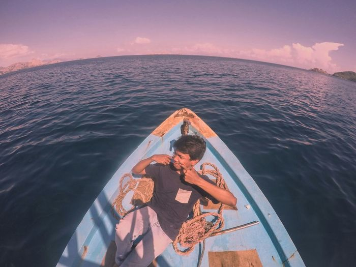 keep smile in the sunset moment INDONESIA Beautiful Sweetmoment Relaxing Moody Relaxing Time Magical Sunset Ocean Blue Sea Beautiful Sky ⛅ colour of life NewEyeEmPhotographer Neweyeemhere Amazing View Nature People Smile EyeEm Selects Water Sea Boat Deck Nautical Vessel Summer Togetherness Horizon Over Water Sky Seascape