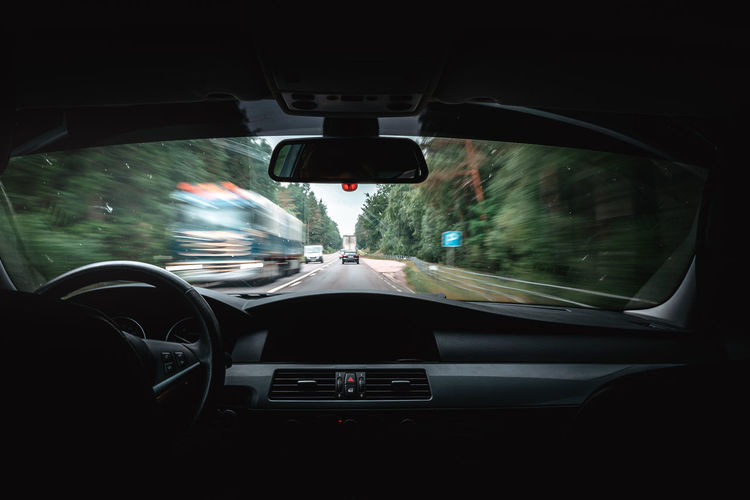 Blurred Motion Car Car Interior Car Point Of View Driving Glass - Material Indoors  Land Vehicle Mode Of Transportation Motion Motor Vehicle on the move Rain Rainy Season Rear-view Mirror Road Road Trip Speed Transparent Transportation Travel Vehicle Interior Windshield