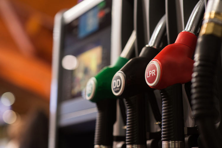 Close-up of multi colored fuel pumps at gas station