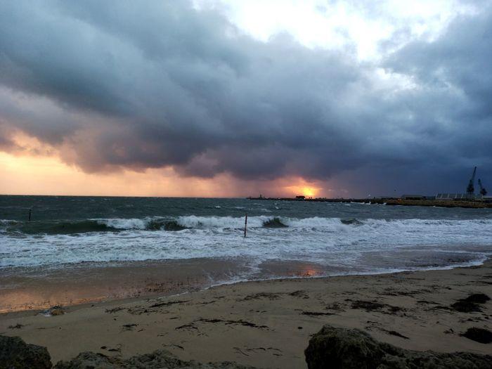 Sunset on Bathers Beach. Winter Southern Winter Indian Ocean Water Wave Sea Sunset Beach Power In Nature Sand Storm Cloud Sun Tide Surf Seascape Coast