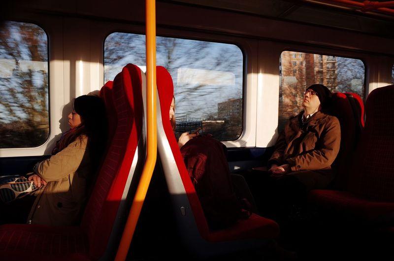 People relaxing in bus
