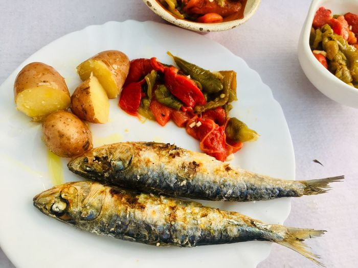 Plate of portuguese sardines Grilled Grill Sardines Food And Drink Food Freshness Ready-to-eat Plate Seafood Table Vegetable Close-up