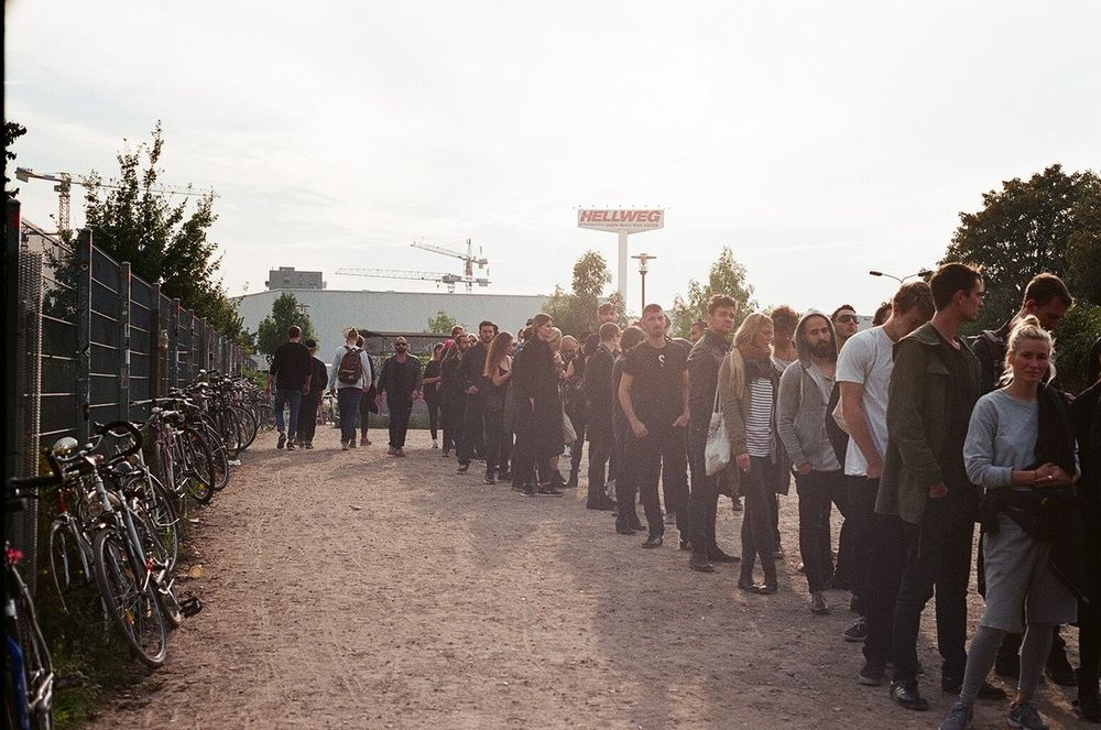 Berghain Berghain Berlin Berlin Casual Clothing City Life Club Day Diminishing Perspective Leisure Activity Lifestyles Medium Group Of People Men Mixed Age Range Outdoors Queue Sky The Way Forward Tree Vanishing Point