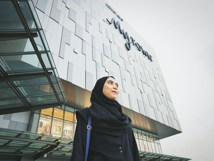 A lady standing outside Mytown Mall Malaysia in Cochrane wearing all Black Young Women City Women Human Body Part Outdoors Architecture Day Lifestyle