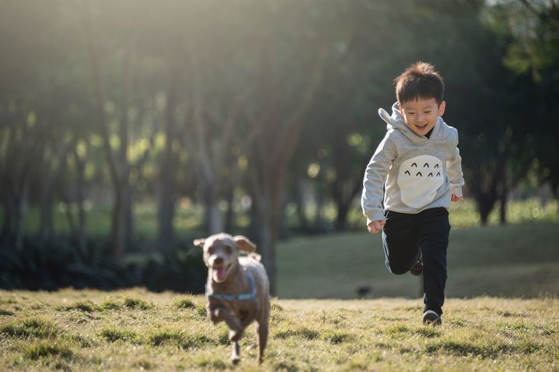 Capture The Moment Motion Atmospheric Mood Nikon Taking Photos Photooftheday Photographer EyeEm EyeEm Gallery EyeEm Best Shots Simplicity Lifestyles Life Day People One Animal Real People Cute Smiling Fun Happy Happiness Outdoor Photography Outdoors Dog Pets Child Childhood Boy Family