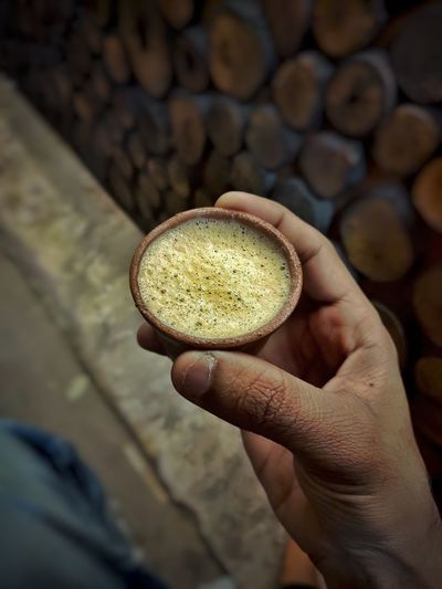 Close-up of hand holding cup of tea