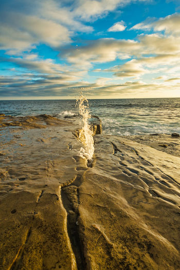 Water spouting out of a crack in the rocks in La Jolla, California La Jolla California San Diego Beach Beauty In Nature Cloud - Sky Day Horizon Horizon Over Water Idyllic La Jolla Land Motion Nature No People Non-urban Scene Ocean Pacific Ocean San Diego Ca Scenics - Nature Sea Sky Sunset Tranquil Scene Tranquility Water