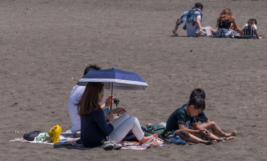 People relaxing on beach