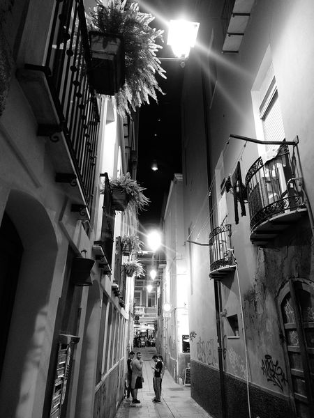 Poetic Bnw_collection Bnwphotography Cagliari By Night Summerinthecity Illuminated Men Architecture Built Structure Building Historic Lantern