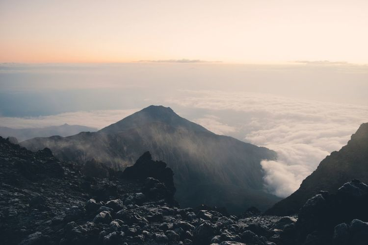 Scenic view of mountains against sky during sunrise, mount meru, arusha national park, tanzania