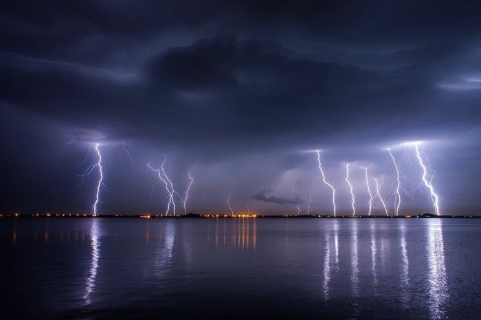 Not my Photo Lightning Thunderstorm Forked Lightning Power In Nature Storm Weather Night Dramatic Sky Storm Cloud Extreme Weather Electricity  Water Illuminated Beauty In Nature No People Nature Outdoors Sky Cyclone