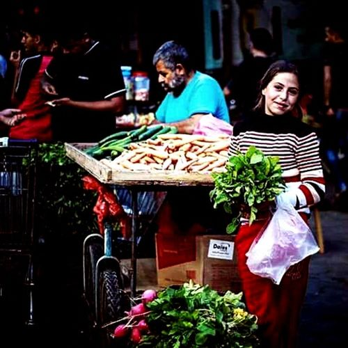 Vendor Radish Food Market Healthy Eating Customer  Adult Healthy Lifestyle Business Finance And Industry People Two People Freshness Groceries Only Women Fruit Adults Only Women Business Outdoors Day Supermarket Gaza-Palestine