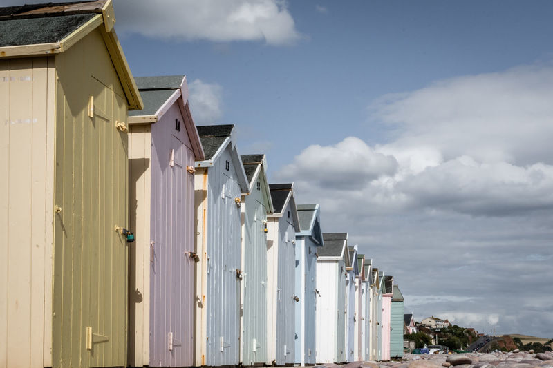 Architecture Beach Beach Hut Building Building Exterior Built Structure Cloud - Sky Day House In A Row Land Low Angle View Nature No People Outdoors Residential District Sky Sunlight Water White Color