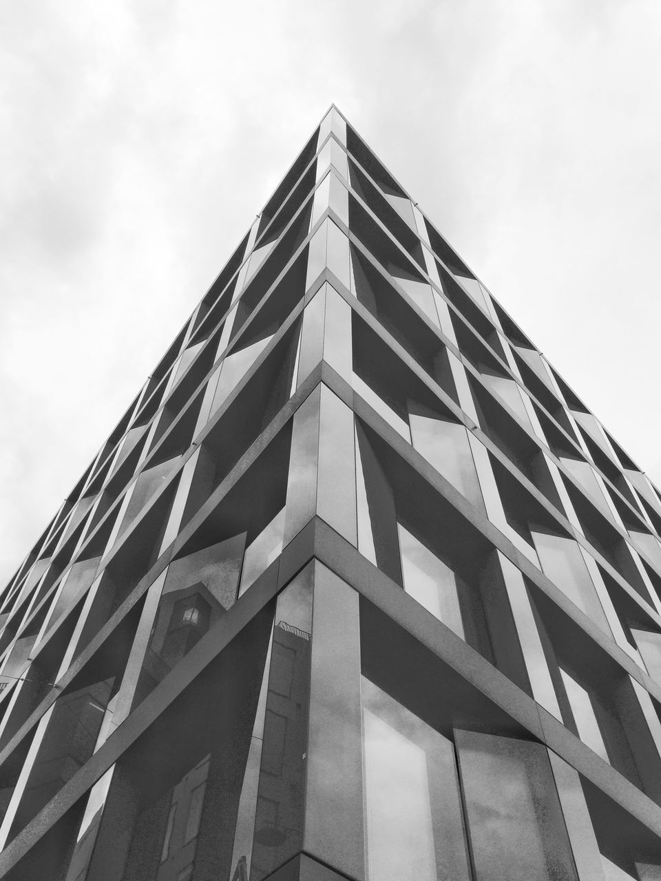 low angle view, building exterior, architecture, built structure, modern, sky, day, outdoors, window, no people, skyscraper, city