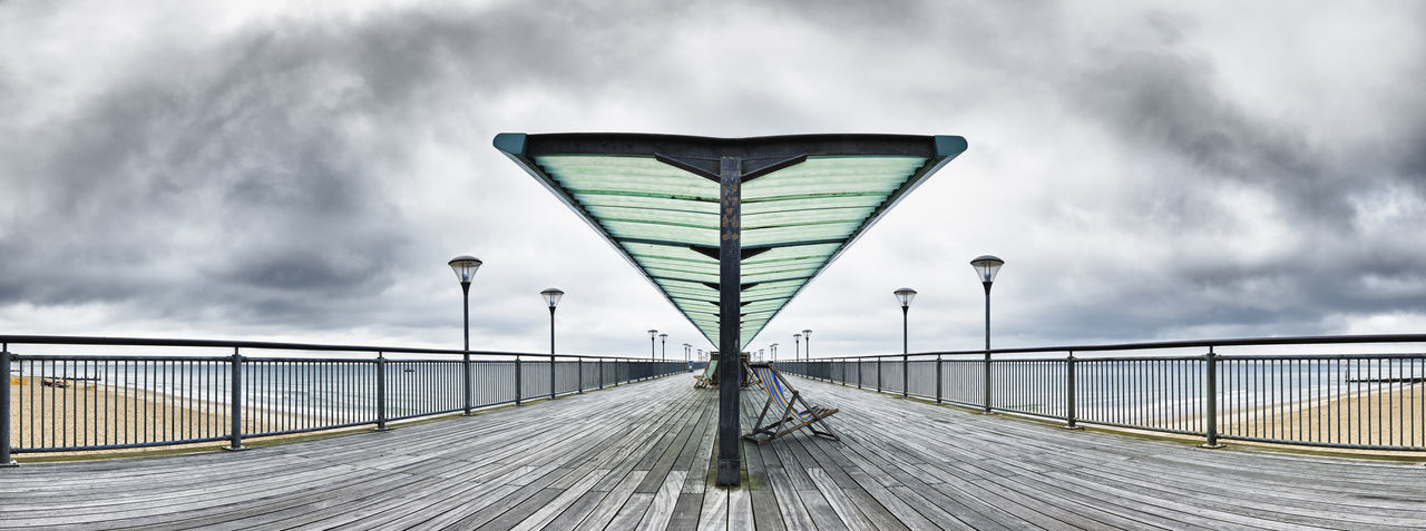 Panoramic view of Boscombe Pier on south coast of England Architecture Coastline England, UK Panorama Pier WoodLand Boardwalk Boscombe Pier  Coast Deckchair Metal Industry Scenics Sea Seaside Shelterlife Structures & Lines
