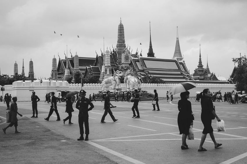 The Grand Palace. Bangkok. The mourning period for the death of the most loved king of Thailand on its 12th day. People all over Thailand, locals and foreigners alike, wear black shirts and dresses signifying their sympathy to the country and respect to the king who died dedicating his life to serve his people. ASIA Built Structure City Cultures Grand Palace Bangkok Thailand Large Group Of People Lifestyles Mourning People Real People Royalty Thailand Travel Welcome To Black