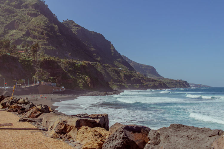 Discovering Tenerife Water Sea Sky Mountain Scenics - Nature Beauty In Nature Beach Land Rock Clear Sky Tranquil Scene Nature Rock - Object Tranquility Solid No People Wave Rock Formation Outdoors Rocky Coastline Tenerife Tenerife Island