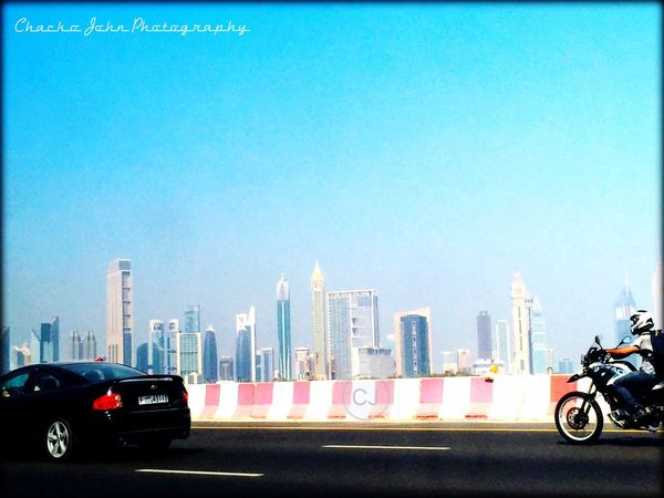 Street life Photography Camera: iPhone 6Plus App: pixlr Location: Dubai Transportation Mode Of Transport Land Vehicle Car Road Bicycle Stationary Parking City Clear Sky Blue Architecture Modern Tower Urban Skyline Light Tall Day Cycle Colourful Trust