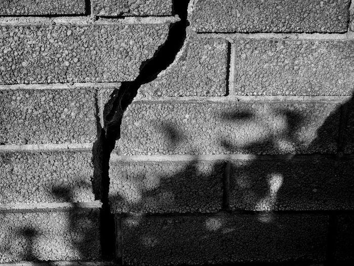 The crack in the wall Black & White Brick Wall Bricks Crack Crack Shadow Crack Wall No People The Crack Wall Wall Cracks