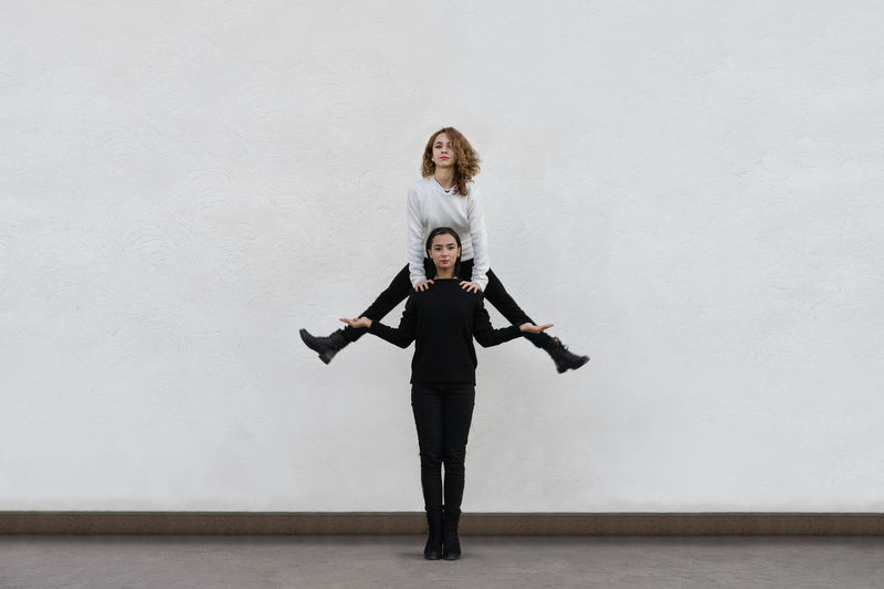 Two People People Real People Sisters Jumping Young Women Portrait Full Length Women Flexibility Standing Looking At Camera Friendship Females Ballet Acrobatic Activity Grace Energetic A New Perspective On Life