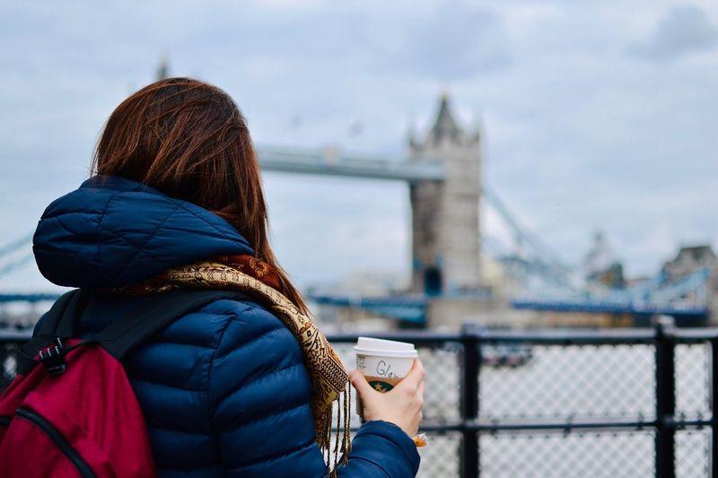 Rear view of woman drinking coffee in london