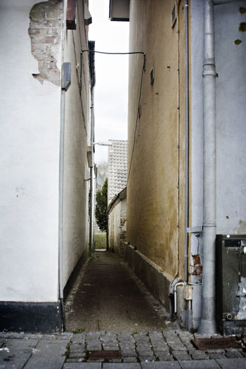 Alley Architecture Broken Building Exterior Built Structure Day No People Outdoors Rough Secret Places Sky The End Of The Road  The Secret Spaces The Way Forward Urban Walkway