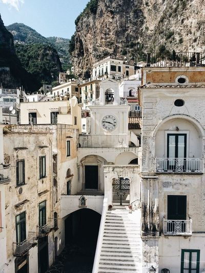 Buildings Against Mountains At Amalfi Coast