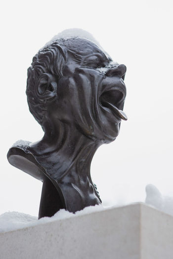 Snow licker Art And Craft Representation Sculpture Statue Creativity Human Representation Sky No People Craft Day Close-up Clear Sky Architecture Male Likeness Focus On Foreground Outdoors Built Structure