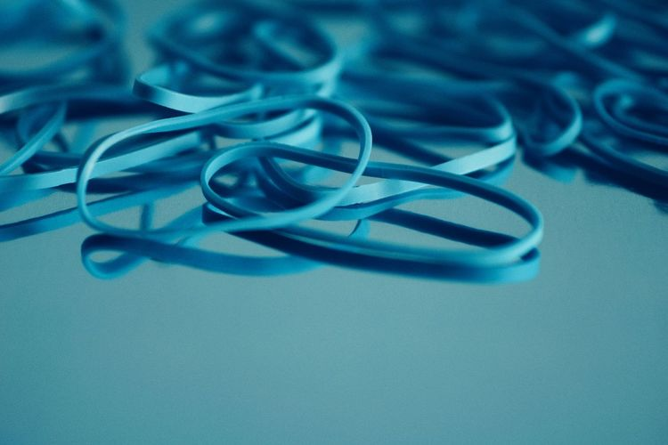 High angle view of rubber bands on table