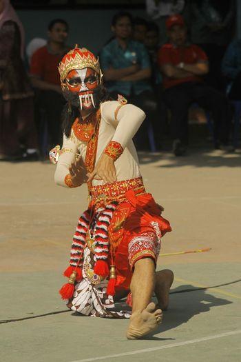 Full length of senior man in traditional clothing during festival