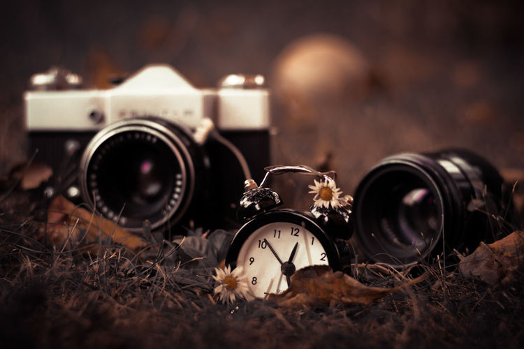 Close-Up Of Clock And Camera
