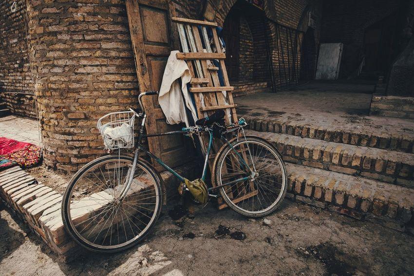 Bike... Bicycle No People Land Vehicle Uzbekistan Street Traveling Streetphotography City Urban Street Photography Tourism Cityscapes Urbanphotography Old Town Fujifilm_xseries Khiva Travel Destinations Xf10-24mm Fujifilmru Xt20 Fujifilm X-t20 Building Exterior Day Urban Geometry