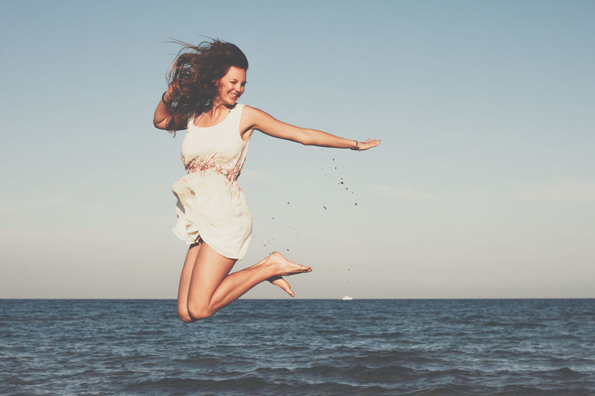 Beauty in j o y. Beach Beautiful Woman Beauty Beauty In Nature Clear Sky Day Fun Girl Happiness Joy Joyful Joyful Moments Jump Jumping Lifestyles Long Hair One Person Real People Sea Smiling Summer Water Woman Young Adult Young Women