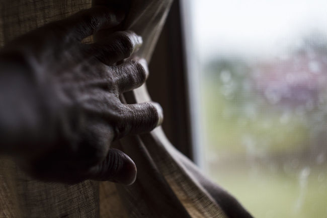 Hand moves the curtains to the side. Drops Rain Close-up Curtain Day Focus On Foreground Glass - Material Hand Human Body Part Human Representation Indoors  One Person Representation Selective Focus Textile Transparent Window