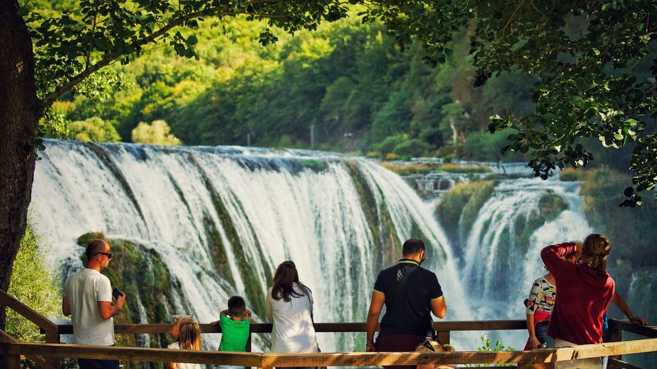 Tourists Waterfall Water Flowing Water Motion Tree Long Exposure Men Day Outdoors River Vacations Nature Togetherness People Travel Destinations Happiness Beauty In Nature Real People An Eye For Travel