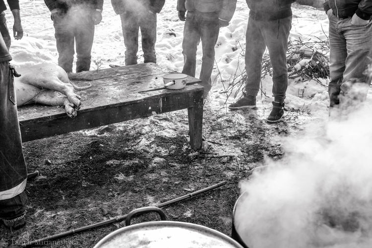 """""""Pig's Funeral"""" i.e. tradition of pig slaughtering at New Year's Eve in Kakheti, East part of Georgia (country). A photo from the series of the Georgian Traditions. The Art Of Street Photography Real People Group Of People Standing Animal Leg Village Life Rural Area Rural Scene Pig Slaughtering Black & White Documentary Photography Kakheti Georgia Georgian Traditionals Food Tamar Mirianashvili"""