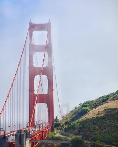 Golden gate bridge against sky in foggy weather