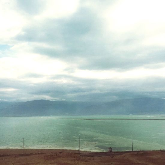 Sky Cloud - Sky Sea Water Tranquility Nature Scenics Tranquil Scene Day Beauty In Nature Outdoors Horizon Over Water Beach No People Animal Themes Mammal Deadsea Seas Sea Deadsea_israel