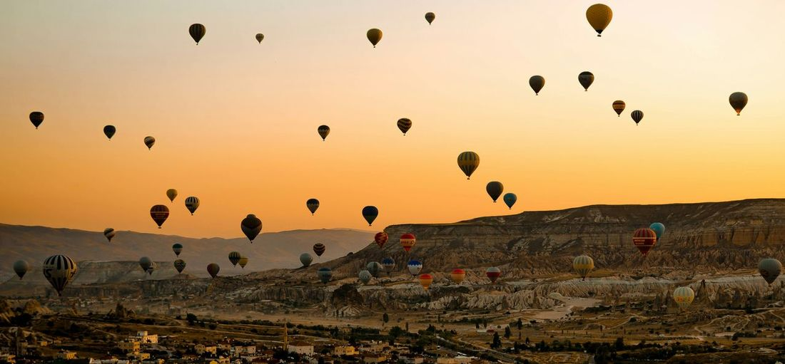 Hot Air Balloons Over Rocky Landscape
