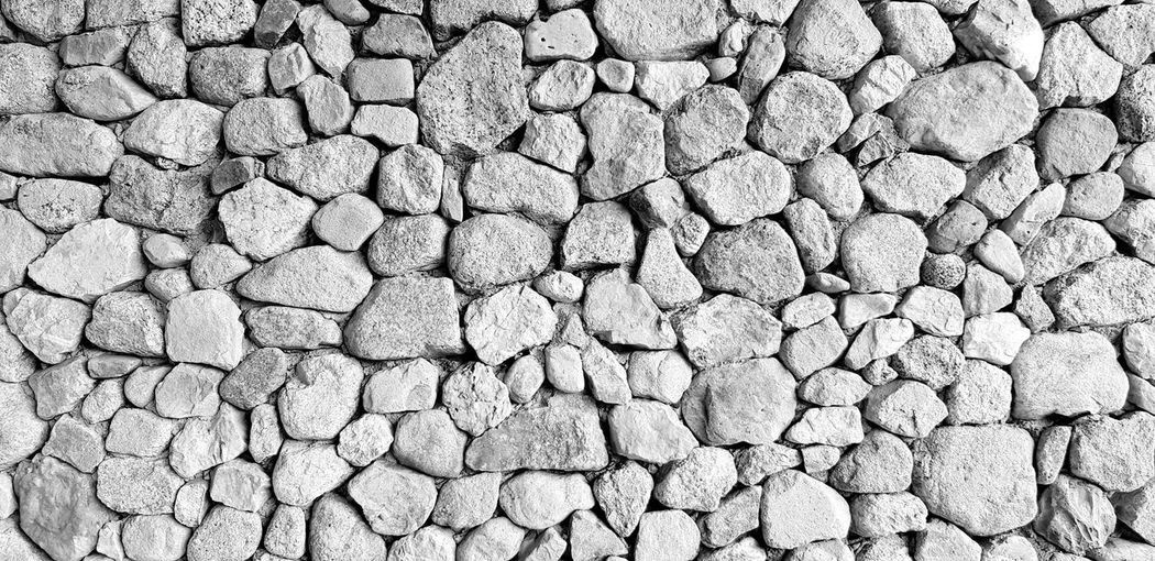 Big gray stone wall for background Backgrounds Full Frame Textured  Large Group Of Objects Solid Stone - Object Abundance Rock High Angle View Close-up Pebble Day Directly Above Pattern Outdoors Stone Nature Gray Rough Textured Effect EyeEmNewHere Surface Wallpaper Wall Art
