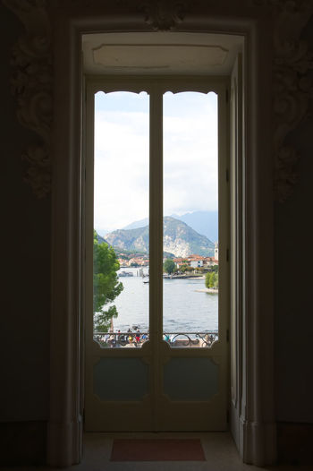 View of Lake Maggiore and its islands from the Borromeo Palace on the Mother Island - Stresa - Italy Bella Mother Stresa View Architecture Borromean Cityscape Day Fishermen Indoors  Island Italy Lake Lake Maggiore Madre Maggiore Mountain Nature No People Palace Scenics Sky Superior Water Window