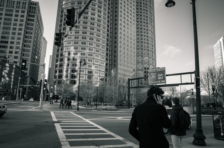 Architecture Blackandwhite Building Exterior Built Structure Car City City Life City Street Communication Here Belongs To Me Lifestyles Men Monochrome People Watching Person Rear View Road Street Streetphotography Text Transportation Urbex Walking