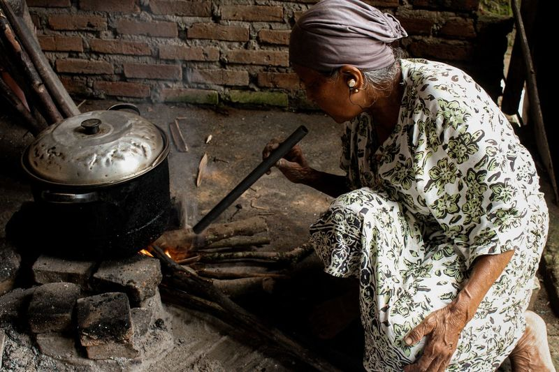 High angle view of woman preparing food