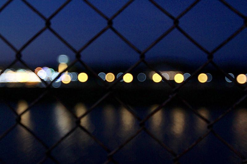 City seen through chainlink fence