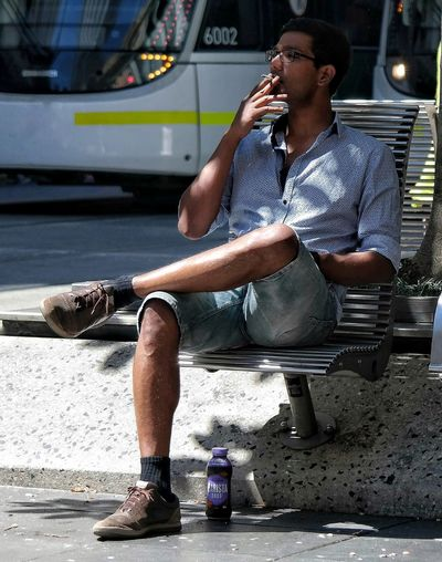 Smoking One Person Refreshment Lifestyles Eyes Closed  Young Adult Holding Sitting Men Real People Outdoors Relaxing City Street Life People Watching Chilling Out People Photography Melbourne City Street Photography Sitting Full Length In The Shade Street Bench Candidly Human The City Light