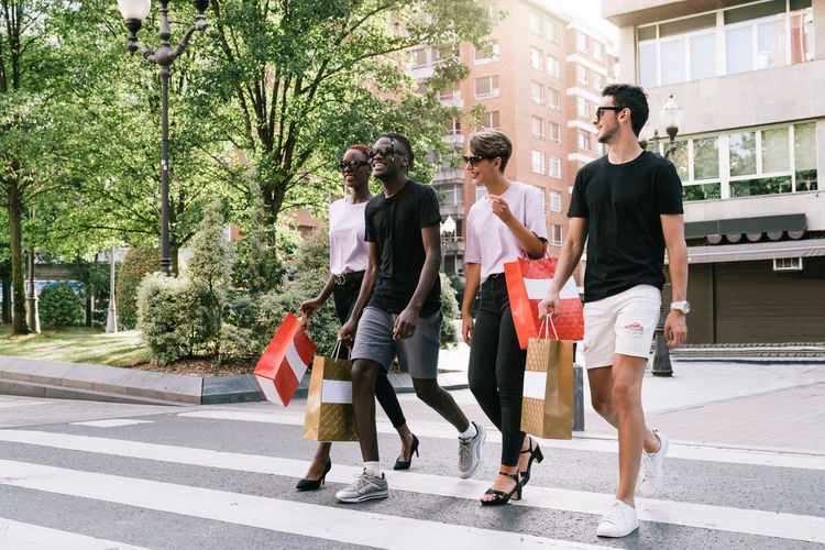 Full length of women walking in city