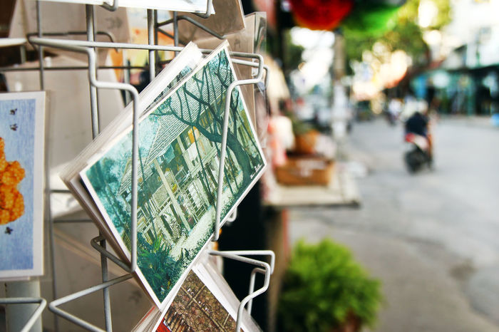 Painted postcards for tourists on a shop window in a souvenir shop. EyeEmNewHere Market Postcard Recieve Souvenirs/Gift Shop Travel Art Built Structure City Communication Creativity Focus On Foreground Gift Memory Nature No People Outdoors Send Shop Sidewalk Souvenir Street Surpise Tourism Vintage
