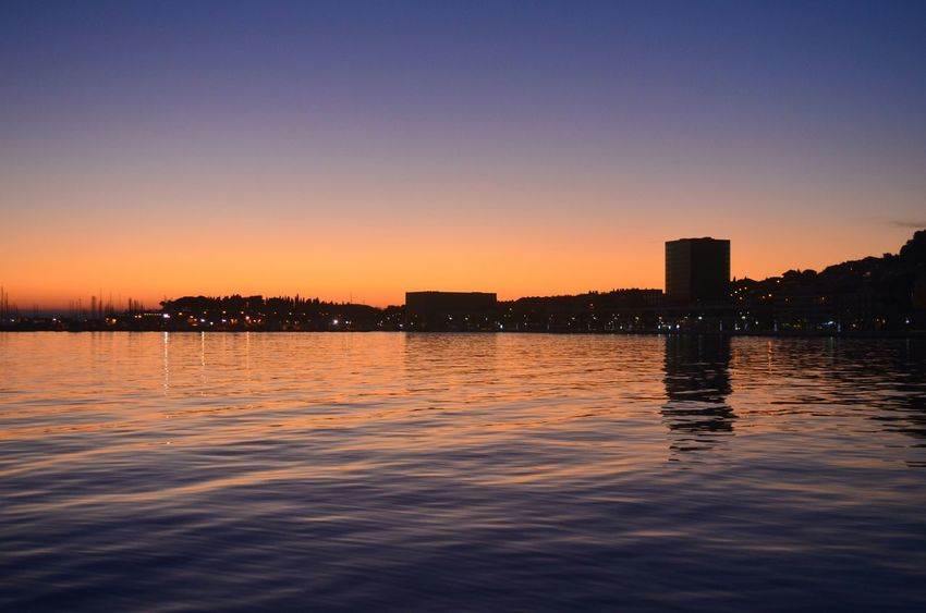 Sunset Water Reflection Sky Urban Skyline Outdoors Cloud - Sky Cityscape No People Split Split Croatia Urban Architecture City Adapted To The City