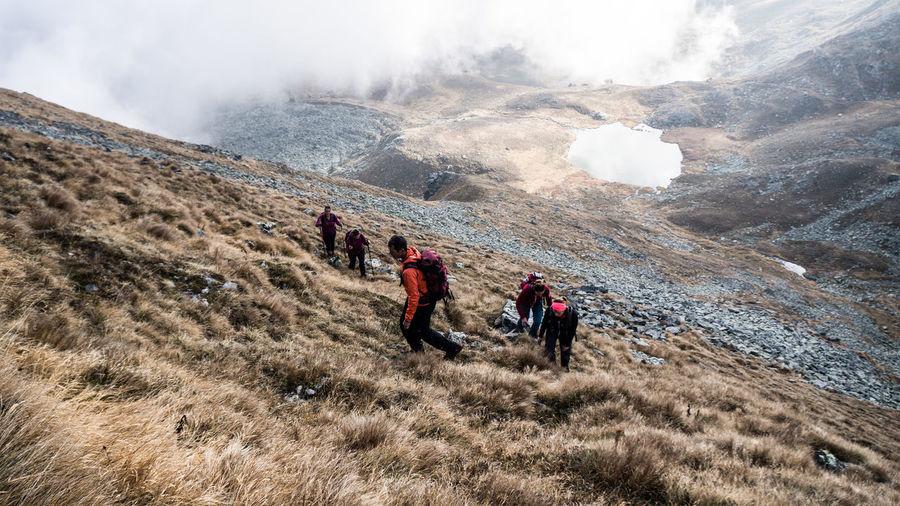 People walking on mountain landscape
