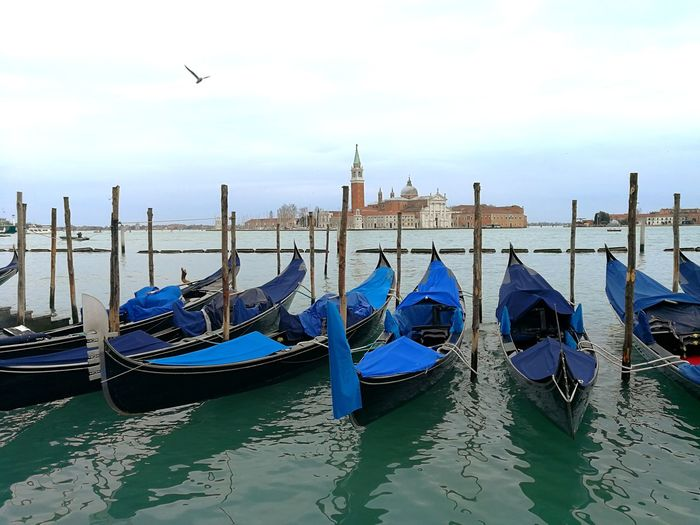 Gondola Gondola - Traditional Boat Water Moored Cultures Nautical Vessel Sky Architecture Boat Canal Gondola Gondolier Venice - Italy Veneto Venetian Lagoon Church Lagoon Grand Canal - Venice Office Building Cathedral